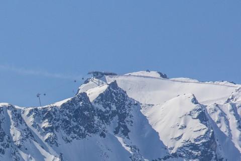 Panorama of Wildspitzbahn Gondola and Wildspitze Peak at Pitztal Glacier