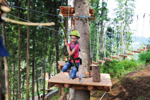 Zip-Line in the high rope course of the XP adventure park